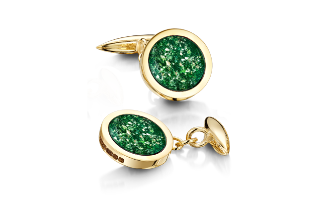 Gold cufflinks inset with green glass with cremated remains incorporated